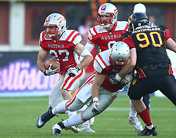 07.06.2014, Ernst Happel Stadion, Wien, AUT, American Football Europameisterschaft 2014, Finale, Oesterreich (AUT) vs Deutschland (GER), im Bild Andreas Hofbauer, (Team Austria, RB, #27), Christoph Gross, (Team Austria, QB, #8), Daniel Schoenet, (Team Austria, RB, #47) und Maximilian Wild, (Team Germany, DL, #90) // during the American Football European Championship 2014 final game between Austria and Denmark at the Ernst Happel Stadion, Vienna, Austria on 2014/06/07. EXPA Pictures © 2014, PhotoCredit: EXPA/ Thomas Haumer