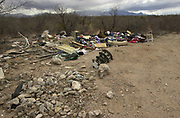 Discarded trash was dumped illegally on public land near Santa Rita Road, Sonoran Desert, Sahuarita, Arizona, USA.
