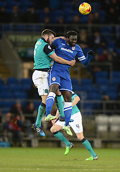 Blackburn Rovers's Jason Lowe battles for a high ball with Cardiff City's Kenwyne Jones - Photo mandatory by-line: Alex James/JMP - Mobile: 07966 386802 - 17/02/2015 - SPORT - Football - Cardiff - Cardiff City Stadium - Cardiff City v Blackburn Rovers - Sky Bet Championship