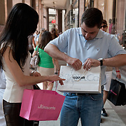 MILAN, ITALY - JULY 03:  Shoppers with several carrier bags are seen in the fashion district of Milan on the first day of the Summer Sales on July 3, 2010 in Milan, Italy. Milan's summer sales start today. .***Agreed Fee's Apply To All Image Use***.Marco Secchi /Xianpix. tel +44 (0) 207 1939846. e-mail ms@msecchi.com .www.marcosecchi.com