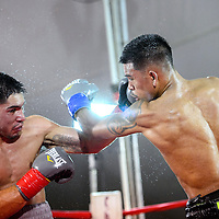 080115       Cable Hoover<br /> <br /> Cameron Kreal, right, and Josh Torres trade blows in the main event of Fire and Ice Fury boxing in Grants Saturday.