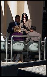 Rebecca Blake and Conor McRedmond (not in frame) at Dubai Courts, Dubai, UAE, February 5, 2013. Photo by Logan Fish / i-Images..Rebecca Blake distinguishing clothing: Tan jacket, black sunglasses, straight black hair.Conor McRedmond distinguishing clothing: Grey suit, white shirt, black sunglasses