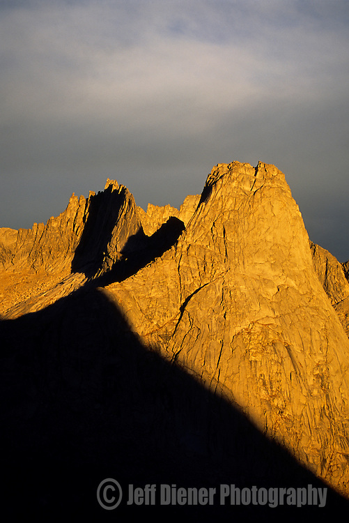 Sunrise illuminates a jagged ridgeline in  the Cirque of the Towers, Wind River Mountains, Wyoming