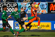 Luton Town defender James Justin (2) gets hit by the ball under the challenge from Coventry City midfielder Tom Bayliss (20) during the EFL Sky Bet League 1 match between Luton Town and Coventry City at Kenilworth Road, Luton, England on 24 February 2019.