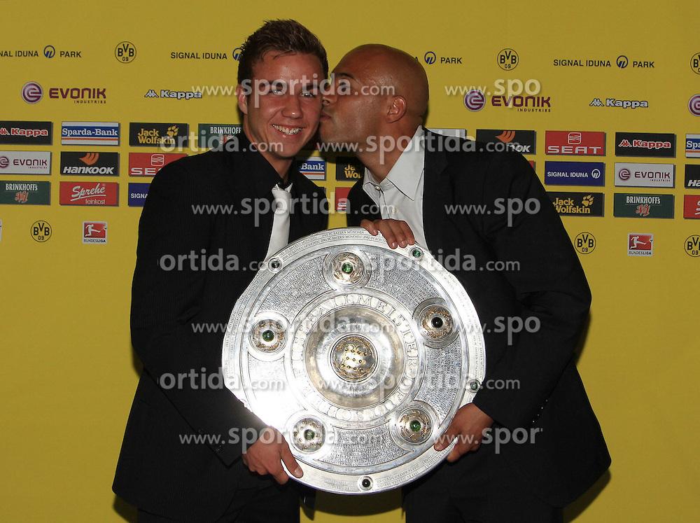 14.05.2011, U-Haus, Dortmund, GER, 1.FBL, Borussia Dortmund Meisterbankett im BildMario Götze mit Meisterschale und Dede  . //   German 1.Liga Football ,  Borussia Dortmund Championscelebration, Dortmund, 14/05/2011 . EXPA Pictures © 2011, PhotoCredit: EXPA/ nph/  Conny Kurth       ****** out of GER / SWE / CRO  / BEL ******