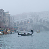 VENICE, ITALY - NOVEMBER 20:  A gondolier sails on the Grand Canal near Rialto Bridge as thick fog shrouds the city, on November 20, 2011 in Venice, Italy. Venice woke up this morning under a heavy blanket of fog adding to the atmosphere of the city. <br /> <br /> HOW TO LICENCE THIS PICTURE: please contact us via e-mail at sales@xianpix.com or call our offices London   +44 (0)207 1939846 for prices and terms of copyright. First Use Only ,Editorial Use Only, All repros payable, No Archiving.© MARCO SECCHI