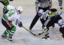 Tomaz Vnuk of ZM Olimpija v Daniel Oberkofler of Linz at ice hockey matchZM Olimpija vs Liwest Linz in second round of semi-final of Ebel League (Erste Bank Eishockey Liga),  on February 28, 2008 in Arena Tivoli, Ljubljana, Slovenia. Win of ZM Olimpija 3:2. (Photo by Vid Ponikvar / Sportal Images)