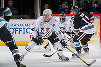 KELOWNA, CANADA - FEBRUARY 16: Dillon Dube #19 of Kelowna Rockets looks for the pass behind Kayle Doetzel #8 of Red Deer Rebels on February 16, 2016 at Prospera Place in Kelowna, British Columbia, Canada.  (Photo by Marissa Baecker/Shoot the Breeze)  *** Local Caption *** Dillon Dube; Kayle Doetzel;