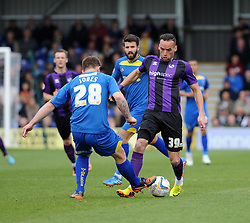 Bristol Rovers' Kaid Mohamed challenges for the ball with AFC Wimbledon's Darren Jones - Photo mandatory by-line: Dougie Allward/JMP - Mobile: 07966 386802 05/04/2014 - SPORT - FOOTBALL - Kingston upon Thames - Kingsmeadow - AFC Wimbledon v Bristol Rovers - Sky Bet League Two