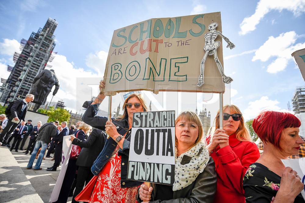 © Licensed to London News Pictures. 28/09/2018. LONDON, UK. Head teachers with placards join hundreds of other head teachers at a rally in Parliament Square to demand extra funding for schools ahead of a petition being delivered to Number 11 Downing Street.  With a reported reduction in per student funding in real terms since 2010, members of the National Union of Head Teachers and the Association of School and College Leaders attending the rally also warn of increasing class sizes, staff cuts, and reduced subject choice.  Photo credit: Stephen Chung/LNP