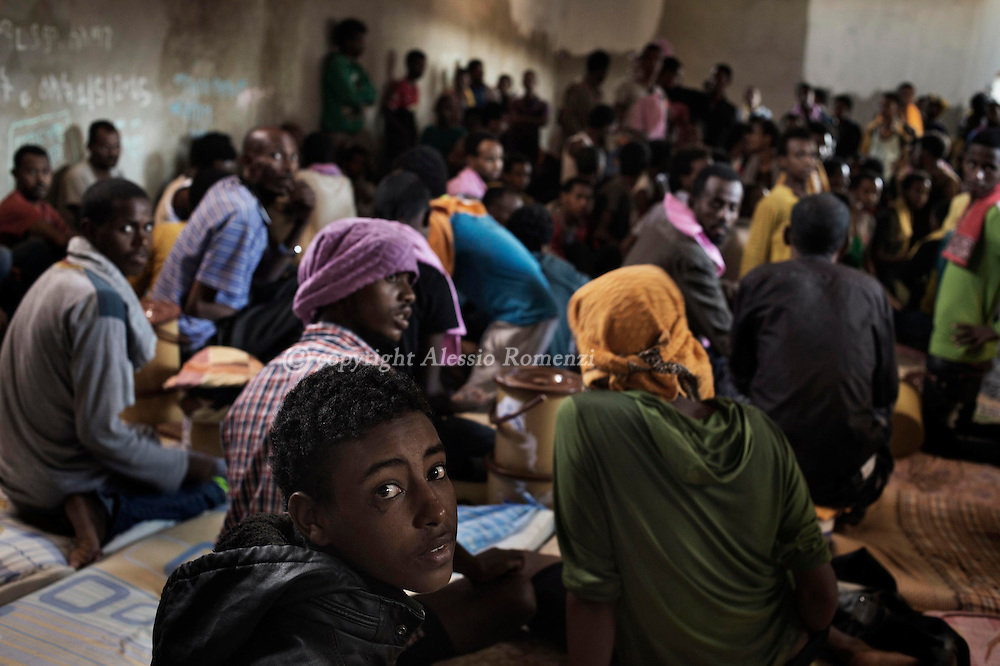 Libya, Zawiya District: migrants captured at the sea as they were attempting to reach Italy are seen inside an overcrowded cell at Zawiya detention center on May 13, 2015. Alessio Romenzi