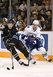 April 8, 2010; San Jose, CA, USA; San Jose Sharks left wing Dany Heatley (15) skates past Vancouver Canucks left wing Matt Pettinger (13) during the first period at HP Pavilion. San Jose defeated Vancouver 4-2. Mandatory Credit: Jason O. Watson / US PRESSWIRE