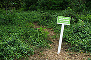 """Help us protect these plantings Please keep out"" sign in Central Park"
