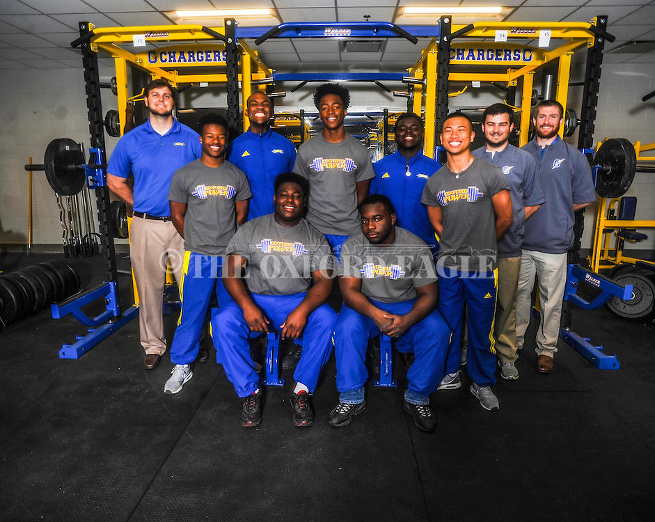 The Oxford High powerlifting team, in Oxford, Miss. on Monday, April 16, 2016, won the school's fourth consecutive powerlifting championship on Saturday, April 16, 2016 in Jackson, Miss. The team is, sitting from left, Jacquez Neilson and Brandon Hill, and standing, from left, coach Jason Russell, Tias Hilliard, Kent Hickinbottom, DQ Thomas, Nick Sisk, Alex Le, and coaches Chris Cutcliffe and Matt McCrory.