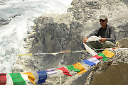 Patrick Morrow the first Canadian to summit Everst returns to Everst base camp 25 years later. Here, as we leave the ice field, he strings across Tibetan prayer flags as an adieu  to the mountain. Production still - The Climb.