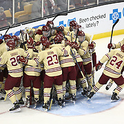 Members of the Boston College Eagles huddle during The Beanpot Championship Game at TD Garden on February 10, 2014 in Boston, Massachusetts. (Photo by Elan Kawesch)