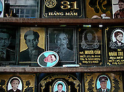 Vietnam, Hanoi: tombstones with Ho Chi Min in the middle.
