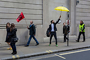 Environmental activists protest outside the Bank of England in the City of London on the 11th and final day of protests, road-blockages and arrests across London by the climate change campaign Extinction Rebellion, on 25th April 2019, in London, England.