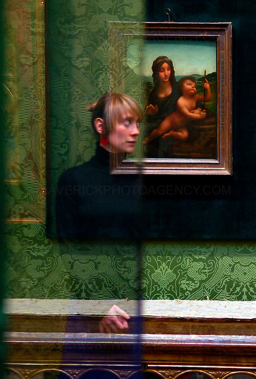 Leonardo Da Vinci's Madonna of the Yarnwinder goes on display at the National Gallery of Scotland from today, Thursday 17th December 2009...In 2003 it was stolen from Drumlanrig Castle, the Dumfriesshire home of the Duke of Buccleuch and Queensberry. ..The Madonna of the Yarnwinder is the only painting by Leonardo Da Vinci in Scotland and is on loan to the gallery from the Duke and the Trustees of the Buccleuch Heritage Trust...Picture shows Kristina Johansen is reflected in a display cabinet looking at Leonardo Da Vinci's 'Madonna of the Yarnwinder' on display at the National Gallery of Scotland in Edinburgh.