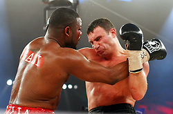 Ukrainian boxer Vitali Klitschko trades with  challenger Juan Carlos Gomez of Cuba in their WBC heavyweight title fight on March 21, 2009 at the Hanns-Martin-Schleyer-Halle in Stuttgart, southern Germany.