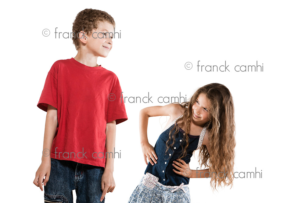 caucasian little boy and girl portrait isolated studio on white background