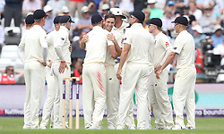England's Chris Woakes (centre) celebrates taking the wicket of Pakistan's Asad Shafiq, during day one of the second Investec Test Match at Headingley Carnegie, Leeds.