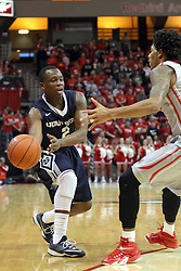 16 November 2014:  Darius Perkins bounces a pass inside during an NCAA non-conference game between the Utah State Aggies and the Illinois State Redbirds.  The Aggies win the competition 60-55 at Redbird Arena in Normal Illinois.