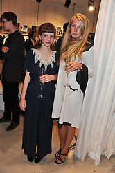 Left to right, AMY GLOVER and OTTOLINE HART  at the launch of the Spencer Hart Flagship store, Brook Steet, London on 13th September 2011.