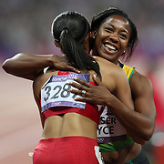 Allyson Felix, USA, (left), winning the Gold Medal in the  Women's 200m Final, is congratulated by Silver Medal winner Shelly-Ann Fraser-Pryce, Jamaica, at the Olympic Stadium, Olympic Park, during the London 2012 Olympic games. London, UK. 8th August 2012. Photo Tim Clayton