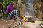 Africa, Ethiopia, Omo region, Chencha, Dorze village. Woman prepares bread from the shaving a leaf of the fruitless Banana. These shavings are a major ingredient in the local bread