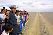 GOBI DESERT, MONGOLIA..08/26/2001.Bayangovi. Local Naadam festival. Visitors waiting for the finish of a horse race over 30 kilometers..(Photo by Heimo Aga).