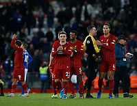 Football - 2019 / 2020 Premier League - Liverpool vs. Everton<br /> <br /> \Xherdan Shaqiri, Adrian and Virgil van Dijk of Liverpool applaud the Kop at the end of the game , at Anfield.<br /> <br /> COLORSPORT/ALAN MARTIN