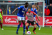Carlisle United Defender Troy Archibald-Henville and Exeter City Midfielder Arron Davies battle during the Sky Bet League 2 match between Carlisle United and Exeter City at Brunton Park, Carlisle, England on 17 October 2015. Photo by Craig McAllister.