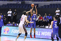 September 17, 2018 - Quezon City, NCR, Philippines - Scottie Thompson (Blue) of the Philippines takes a shot over Nasser Khaifa Al-Rayes (White) of Qatar. (Credit Image: © Dennis Jerome S. Acosta/Pacific Press via ZUMA Wire)