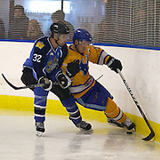 Southern Stampede player Simon Glass (right)  takes a hit from West Auckland Admirals player Lance Zonneveld during the Southern Stampede V West Auckland Admirals New Zealand Ice Hockey League match at the Queenstown Ice Arena, Queenstown, South Island, New Zealand, 4th June 2011