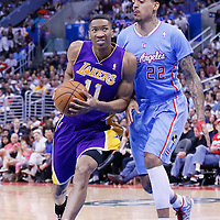 06 April 2014: Los Angeles Lakers forward Wesley Johnson (11) drives past Los Angeles Clippers forward Matt Barnes (22) during the Los Angeles Clippers 120-97 victory over the Los Angeles Lakers at the Staples Center, Los Angeles, California, USA.