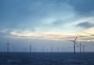 19/03/2014. Gwnt y Mor Wind Farm, North Wales, UK. A view of the turbines and foundations on the Gwynt y Mor Offshore Wind Farm off the coast of North Wales during sunrise. Photo credit : Rob Arnold