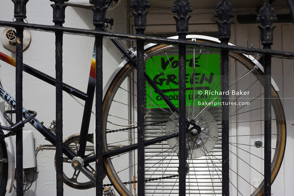 A Green Party sign and bicycle urging voters to vote for Brighton candidate Caroline Lucas.