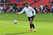 Tyler Roberts (11) of Leeds United warming up before the EFL Sky Bet Championship match between Bristol City and Leeds United at Ashton Gate, Bristol, England on 9 March 2019.