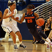 Brittney Sykes, Syracuse, (right) in action against Bria Hartley, Connecticut, during the Connecticut V Syracuse Semi Final match during the Big East Conference, 2013 Women's Basketball Championships at the XL Center, Hartford, Connecticut, USA. 11th March. Photo Tim Clayton
