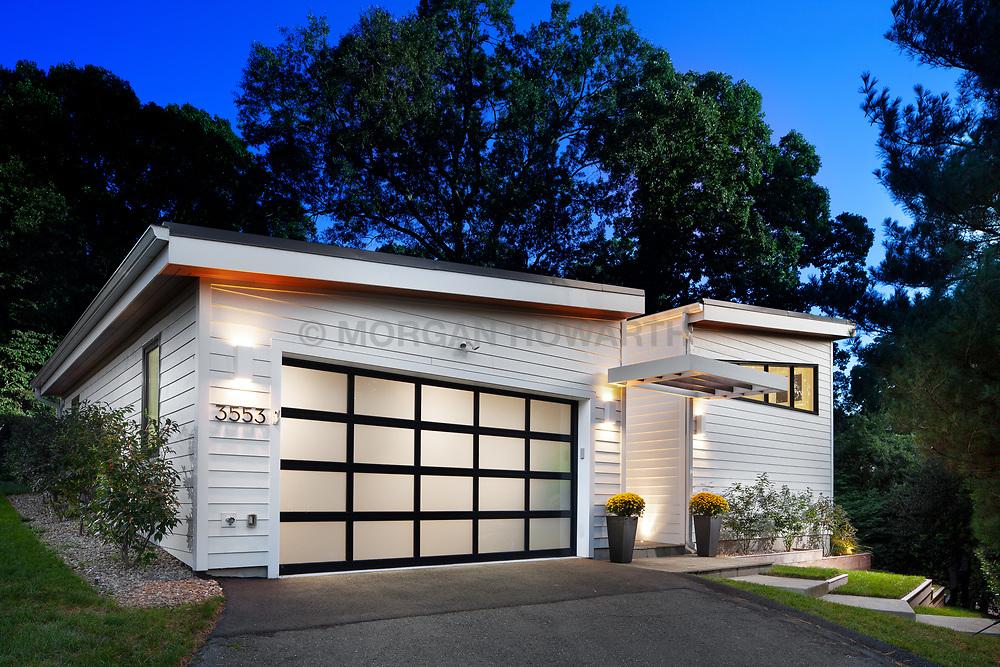 3553 Nellie Curtis Modern Home Exterior twilight with glass garage door VA 2-174-303