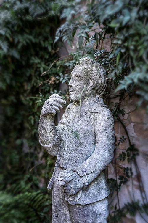 Rustic garden statue