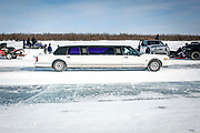 A limo drives down the ice road in Inuvik