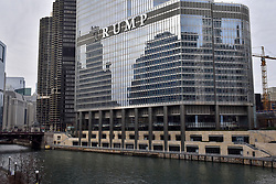 """© Licensed to London News Pictures. 21/12/2017. CHICAGO, USA.  The sign adorning the exterior of Trump International Hotel and Tower in downtown Chicago appears to display the word """"RUMP"""" in 20 foot high letters.  The United Nations has just voted to reject US President Donald Trump's recognition of Jerusalem as capital of Israel.  Photo credit: Stephen Chung/LNP"""