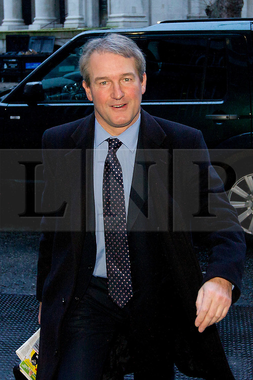 © Licensed to London News Pictures. 12/02/2013. London, UK. Ahead of a parliamentary debate on horse meat found in processed meat products the British Environment Secretary, Owen Paterson, arrives at the Department for Environment, Food and Rural Affairs (DEFRA) in London today 12/02/2013. Mr Paterson is due to meet with food industry representatives for the second time in a week to discuss the horsemeat crisis. Photo credit: Matt Cetti-Roberts/LNP