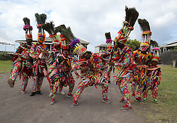 Dancers wait for the arrival of Prince Harry at a youth rally at Brimstone Hill Fortress where he watched a number of cultural performances all led by the young people after arriving on the island of St Kitts for the second leg of his Caribbean tour.