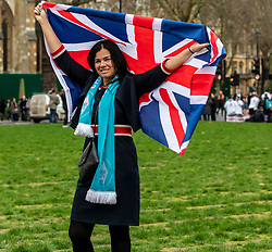 © Licensed to London News Pictures. 31/01/2020. London, UK. Suzie O'Brien a Brexit Party candidate in the General Election waves her flag in Parliament Square this afternoon as supporters start to gather in the square ahead of the expected Brexit celebrations this evening as the UK leave the European Union at 11pm tonight. Photo credit: Alex Lentati/LNP