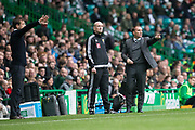 14th October 2017, Celtic Park, Glasgow, Scotland; Scottish Premiership football, Celtic versus Dundee; Dundee manager Neil McCann and Celtic manager Brendan Rodgers pass on instructions to their teams