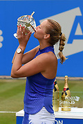 Petra Kvitova of the Czech Republic holds up her trophy and kisses it after the Final of the Aegon Classic Birmingham at Edgbaston Priory Club, Edgbaston, United Kingdom on 25 June 2017. Photo by Martin Cole.
