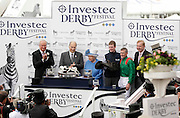 04.06.2016. Epsom Downs, Surrey England.  Britain's Queen Elizabeth presents the trophy to Pat Smullen after he rides Harzand to victory in the  Investec Derby